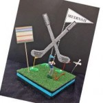 DIY Golf centerpiece with added theme pieces