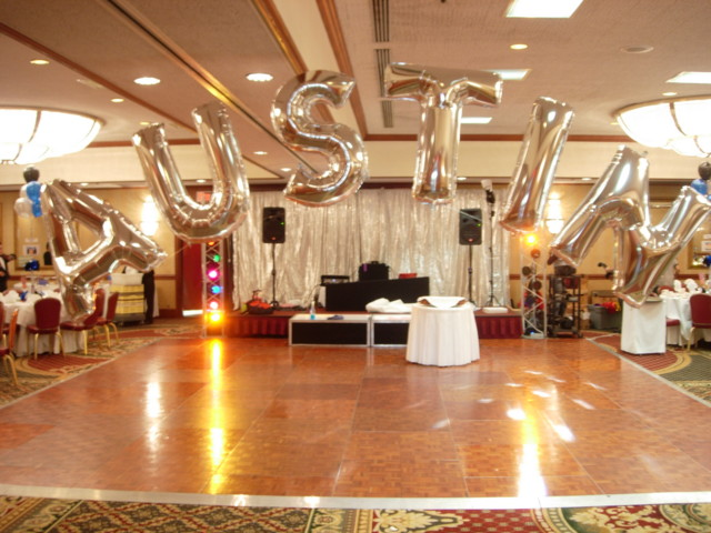 Letter Balloons Spell Out A Name Over Dance Floor