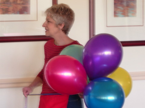 Judy Yublosky setting up party balloons